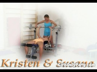 Two chicks toy each other in the gym
