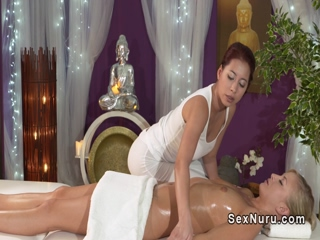 Redhead masseuse massages blondes clit