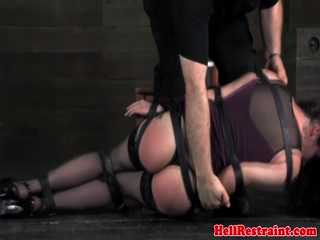 BDSM sub suspended upside down and caned